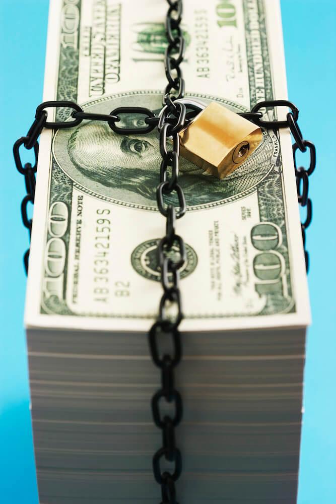 money with lock around it