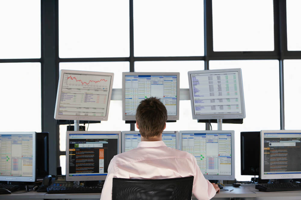 stock market trader computer screens